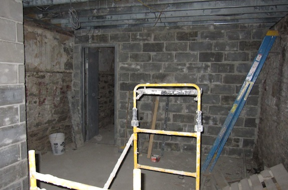 Concrete block wall between storage area and mechanical room