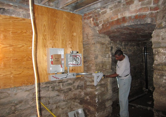 Electrical meters going into cellar near vault room