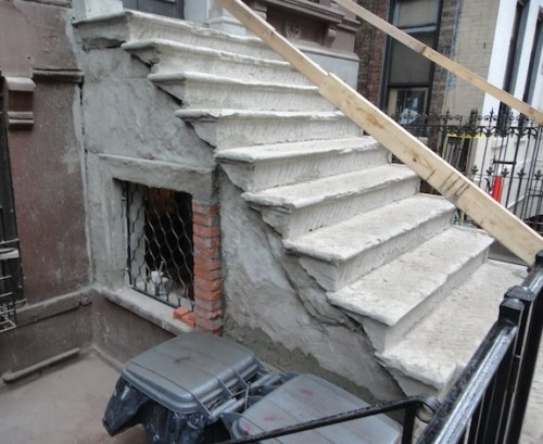 Remove loose brownstone from stoop